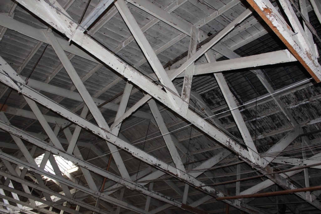 These 88 year old trusses were broken and failing. Since this photo, we've put new trusses next to the old ones to add support while keeping the historical significance.