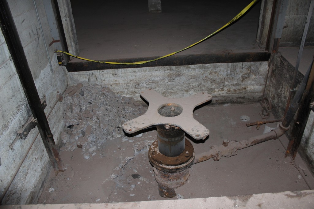 Some of the gears under the second historical elevator in the building.