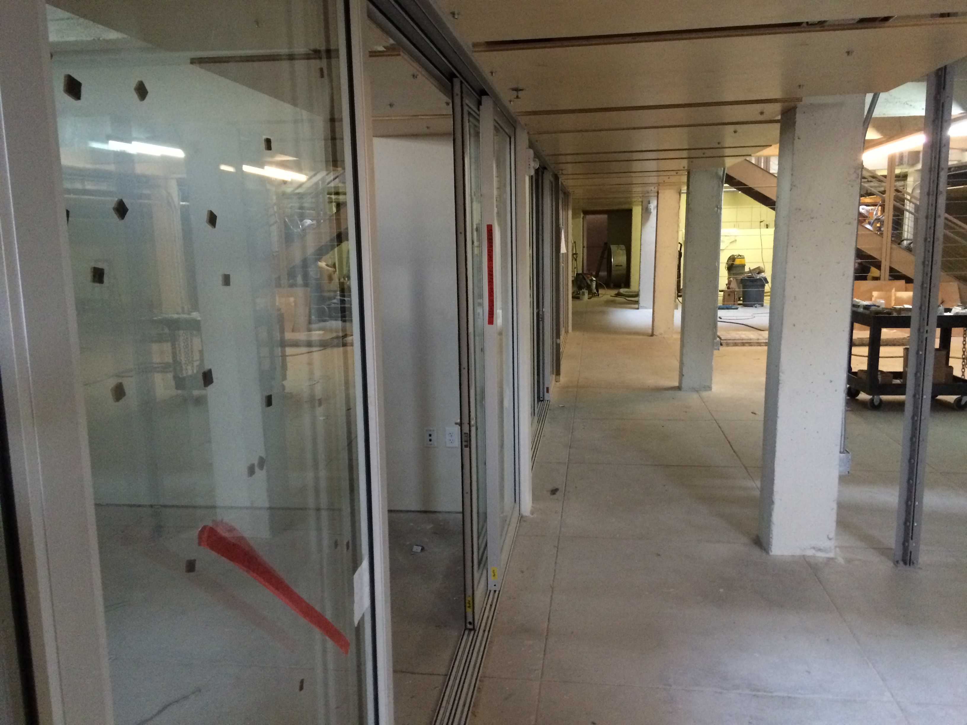 Sliding glass doors were installed on the director's offices to maximize space.