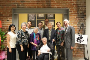 Billy Vassiliadis, Jim King, and Matt Silverman welcome the Ong family and show them the Ong wall, a dedication to the Ong family's legacy.