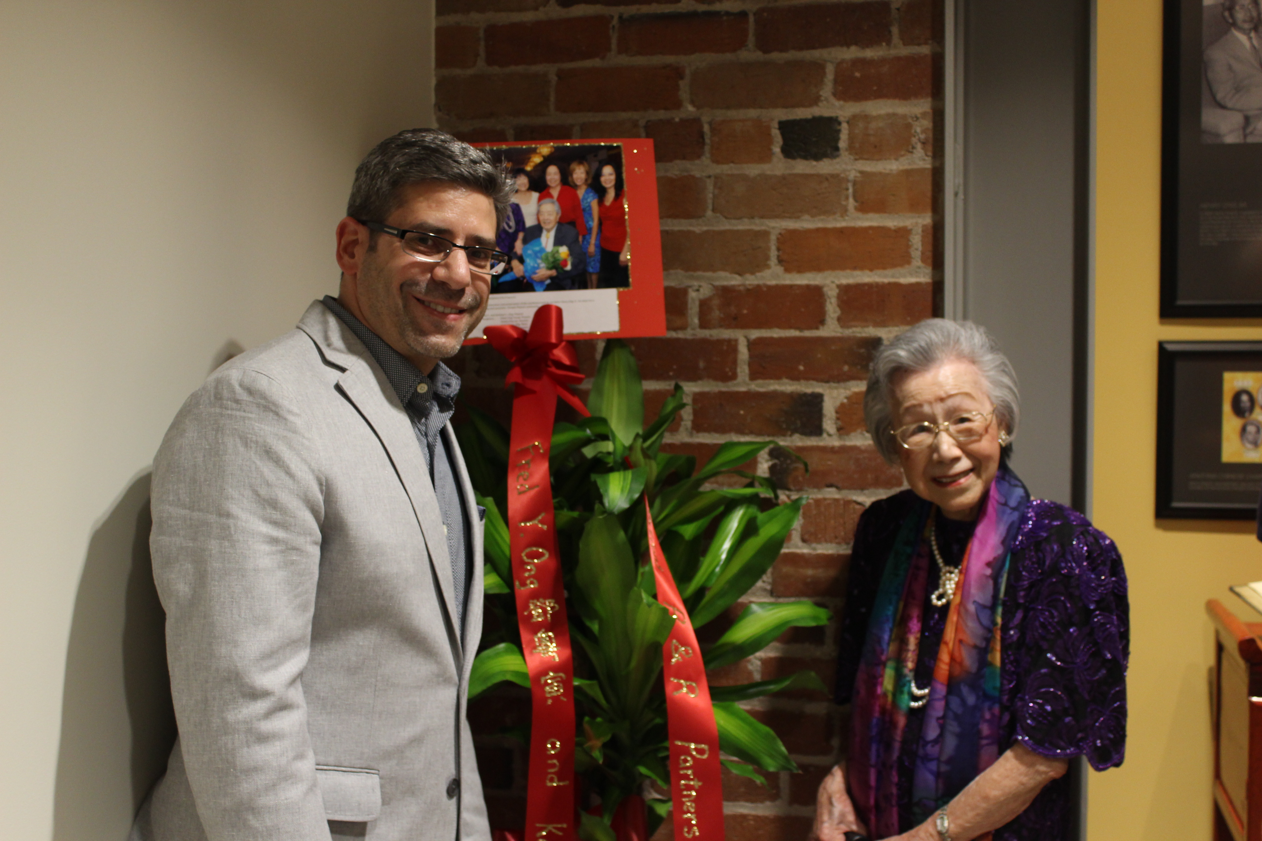Matt Silverman, R&R VP, and Kathleen Ong, part of the Ong family who originally built the warehouse in 1926.